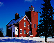 Winter view of the Two Harbors Lighthouse Station completed in 1892 and now the oldest operating lighthouse on the north shore of Lake Superior, Agate Bay, Two Harbors, Minnesota.