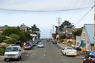 """Manzanita, Oregon, located on Neahkahnie Beach, is a small beach town located in Tillamook County on the Northern Oregon coast.  Manzanita means """"little apple"""" in Spanish. Pictured here is Laneda Street which is lined with small shops."""