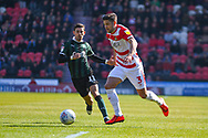 Danny Andrew of Doncaster Rovers (3) in action during the EFL Sky Bet League 1 match between Doncaster Rovers and Plymouth Argyle at the Keepmoat Stadium, Doncaster, England on 13 April 2019.