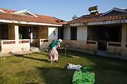 Govindhamma, an elderly resident makes her way back to her room after lunch at the Tamaraikulam Elders' Village, Cuddalore, Tamil Nadu