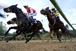 Mohi ridden by Hector Crouch (left) on their way to winning the Download The At The Races App Nursery at Wolverhampton racecourse. Picture date: Monday October 11, 2021.