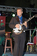 Israel, Mike scott with his banjo on stage at the Jacobs ladder Music festival Nof Ginosar May 2007. Night shot