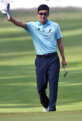 July 15, 2018 - Silvis, Illinois, U.S. - SILVIS, IL - JULY 15:  Michael Kim acknowledges the crowd as he walks down the fairway of the 18th hole during the final round of the John Deere Classic on July 15, 2018, at TPC Deere Run, Silvis, IL.  (Photo by Keith Gillett/Icon Sportswire) (Credit Image: © Keith Gillett/Icon SMI via ZUMA Press)