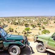 Cars stop to admire the view at an overlook at Tarangire National Park in northern Tanzania not far from Ngorongoro Crater and the Serengeti.