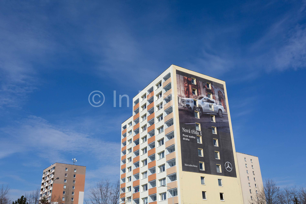New housing and a Mercedes advertising on the side of a tower block near Nadrazi Veleslavin Metro stop, on 20th March, 2018, in Prague, the Czech Republic.