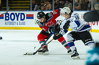 KELOWNA, CANADA - DECEMBER 7: Logan Doust #10 of the Victoria Royals stick checks Leif Mattson #28 of the Kelowna Rockets during second period on December 7, 2018 at Prospera Place in Kelowna, British Columbia, Canada.  (Photo by Marissa Baecker/Shoot the Breeze)
