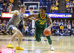 Mar 7, 2020; Morgantown, West Virginia, USA; Baylor Bears guard Davion Mitchell (45) dribbles past West Virginia Mountaineers guard Sean McNeil (22) during the first half at WVU Coliseum. Mandatory Credit: Ben Queen-USA TODAY Sports