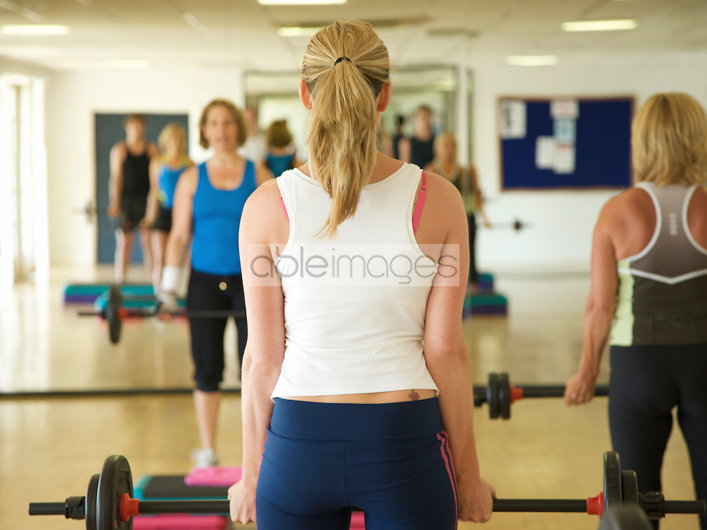 Group of people at a body pump fitness class