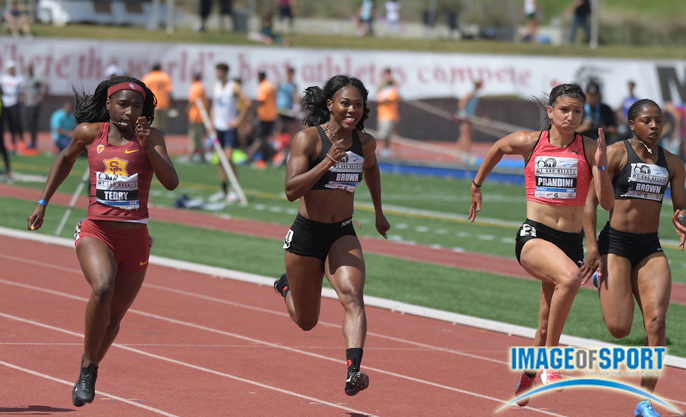 Apr 21, 2018; Torrance, CA, USA; Twanisha Terry of Southern California (left) defeats Aaliyah Brown (second from right), Jenna Prandini (second from left) and Destinne Brown to win the women's 100m in 10.99 during the 60th Mt. San Antonio College Relays at Murdock Stadium.