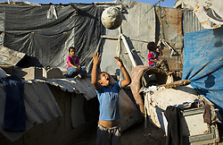 July 3, 2017 - Gaza City, The Gaza Strip, Palestine - Palestinian refugees play in front of their family's home on a hot day in the Jabalya refugee camp in the northern Gaza Strip. (Credit Image: © Mahmoud Issa/Quds Net News via ZUMA Wire)