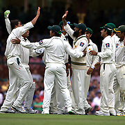 Pakistan celebrate the wicket of Brad Haddin caught Mohammad Yousef bowled Mohammad Asif during the Australia V Pakistan 2nd Cricket Test match at the Sydney Cricket Ground, Sydney, Australia, 3 January 2010. Photo Tim Clayton