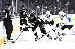 San Jose Sharks  beats Los Angeles Kings 2-1 in NHL hockey game ..Los Angeles Kings' forward Anze Kopitar (front L) controls the puck away from San Jose Sharks' defenseman Marc-Edouard Vlasic (front R) during a 2017-2018 NHL hockey game in Los Angeles, the United States, on Nov. 12, 2017.  San Jose Sharks won 2-1. (Credit Image: © Zhao Hanrong/Xinhua via ZUMA Wire)