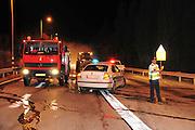 Israel, Northern District, firemen extinguish a burning vehicle