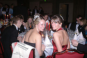 Paula Coyle and Natalie Coyle. White Knights Ball, Grosvenor House. Park Lane. London. 6  January 2006. ONE TIME USE ONLY - DO NOT ARCHIVE  © Copyright Photograph by Dafydd Jones 66 Stockwell Park Rd. London SW9 0DA Tel 020 7733 0108 www.dafjones.com