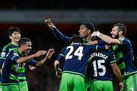 GOAL CELEBRATION - Swansea City's Wayne Routledge celebrates with team mates after scoring his sides equalising goal to make the score 1-1<br /> <br /> Photographer Craig Mercer/CameraSport<br /> <br /> Football - Barclays Premiership - Arsenal v Swansea City - Wednesday 2nd March 2016 - Emirates Stadium - London<br /> <br /> © CameraSport - 43 Linden Ave. Countesthorpe. Leicester. England. LE8 5PG - Tel: +44 (0) 116 277 4147 - admin@camerasport.com - www.camerasport.com