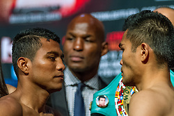 """NEW YORK, NY - OCT 16: Roman """"chocolatito"""" Gonzalez 43-0 (37 KOs) and Brian Viloria 36-4 (22 KOs) stopped the weight at 111.4lbs at the official weigh in for their bout saturday at Madison Square Garden on 16 October, 2015 in New York, NY USA. Byline, credit, TV usage, web usage or linkback must read SILVEXPHOTO.COM. Failure to byline correctly will incur double the agreed fee. Tel: +1 714 504 6870."""