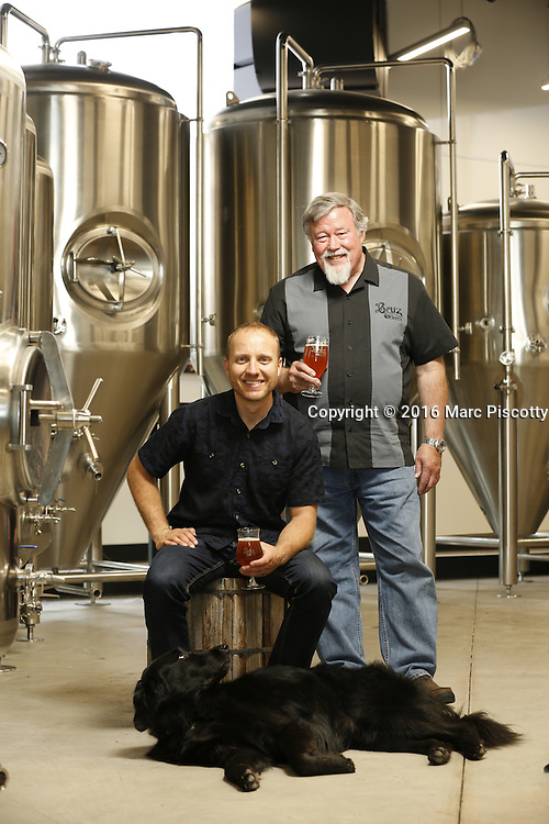 SHOT 7/22/16 2:15:34 PM - Bruz Beers co-founders Charlie Gottenkieny and Ryan Evans inside the new brewery near 67th Avenue and Pecos in Denver, Co. Bruz Beers is Denver's artisanal Belgian-style brewery, featuring a full line of traditional and Belgian-inspired brews, hand-crafted in small batches. Includes images of Evan's dog 'Cooper' as well who serves as the brewery dog. (Photo by Marc Piscotty / © 2016)