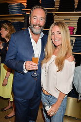 DONNA IDA and her husband BOBBY DAZLER at a party to celebrate the paperback lauch of The Stylist by Rosie Nixon hosted by Donna Ida at her store at 106 Draycott Avenue, London on 17th August 2016.