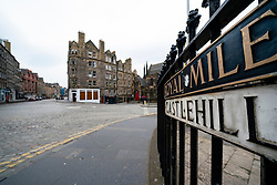 Edinburgh, Scotland, UK. 24 March, 2020.  Deserted streets in the heart of the Old Town tourist district in Edinburgh. All shops and restaurants are closed with very few people venturing outside following the Government imposed lockdown today. Pictured; Empty streets at Castlehill on the Royal Mile. Iain Masterton/Alamy Live News
