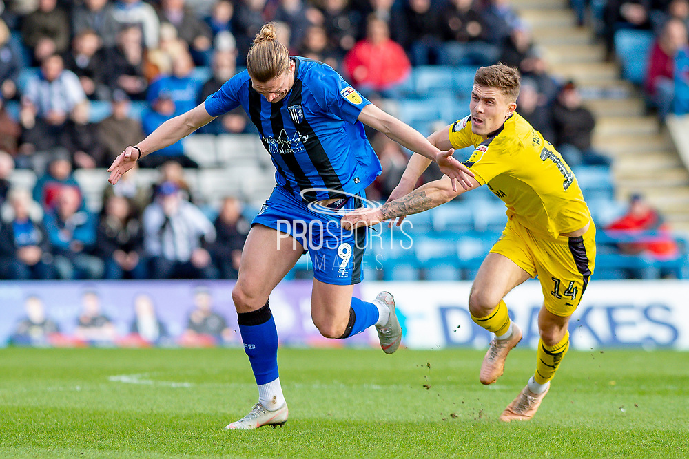 Gillingham FC forward Tom Eaves (9) and Oxford United midfielder Josh Ruffels (14) during the EFL Sky Bet League 1 match between Gillingham and Oxford United at the MEMS Priestfield Stadium, Gillingham, England on 9 March 2019.