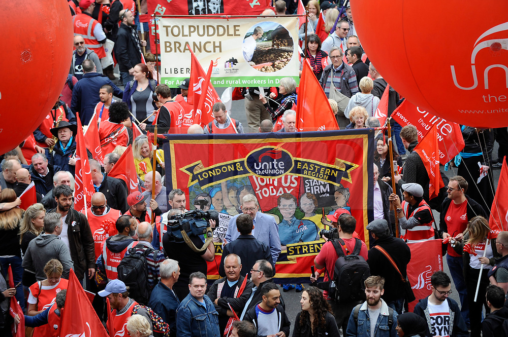 © Licensed to London News Pictures. 12/05/2018. LONDON, UK.  Len McLuskey, General secretary of Unite,(C, sky blue jacket), gives a media interview as thousands of people take part in a Trades Union Congress (TUC) march and rally, from Embankment to Hyde Park, calling for improved workers' pay and rights as well as improvement to pubic services.  Photo credit: Stephen Chung/LNP