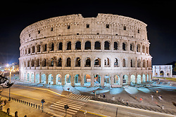 Colosseum lit up at night, Rome, Italy