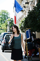 beautiful charming woman at the exit of a hotel with her luggage