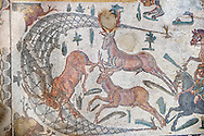 Hunter driving deer into a net from the Room of The Small Hunt, no 25 - Roman mosaics at the Villa Romana del Casale which containis the richest, largest and most complex collection of Roman mosaics in the world, circa the first quarter of the 4th century AD. Sicily, Italy. A UNESCO World Heritage Site. .<br /> <br /> If you prefer to buy from our ALAMY PHOTO LIBRARY  Collection visit : https://www.alamy.com/portfolio/paul-williams-funkystock/villaromanadelcasale.html<br /> Visit our ROMAN MOSAICS  PHOTO COLLECTIONS for more photos to buy as buy as wall art prints https://funkystock.photoshelter.com/gallery/Roman-Mosaics-Roman-Mosaic-Pictures-Photos-and-Images-Fotos/G00008dLtP71H_yc/C0000q_tZnliJD08