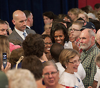 First Lady Michelle Obama's mingles with the audience following her speech at Laconia Middle School Thursday afternoon.  (Karen Bobotas/for the Laconia Daily Sun)