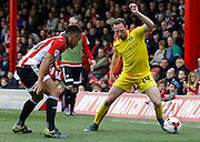 Rotherham United midfielder Aidan White looks to get past Brentford forward Sergi Canos during the Sky Bet Championship match between Brentford and Rotherham United at Griffin Park, London, England on 17 October 2015. Photo by Andy Walter.