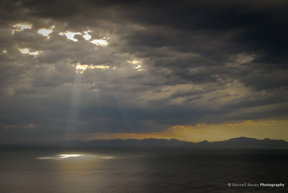 Sun rays on the ocean over False Bay, the Cape of Good Hope, South Africa