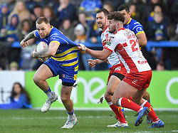 Warrington Wolves' Blake Austin is tackled by Hull Kingston Rovers' George Lawler during the Betfred Super League match at the Halliwell Jones Stadium, Warrington.