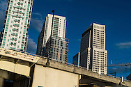 In an optical illusion, high rise buildings appear to slide down a bridge in downtown Miami, Florida. WATERMARKS WILL NOT APPEAR ON PRINTS OR LICENSED IMAGES.