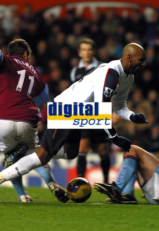 Photo: Dave Linney.<br />Aston Villa v Bolton Wanderers. The Barclays Premiership. 16/12/2006 Bolton's  Nicolas Anelka(R) is brought down by  Stiliyan Petrov.