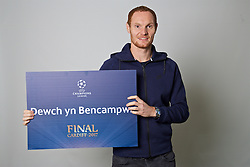 """CARDIFF, WALES - Monday, November 7, 2016: Wales' Shaun MacDonald holds up a board """"Dewch yn Bencampwr"""" to encourage people to become volunteers for the 2017 UEFA Champions League Final in Cardiff. (Pic by David Rawcliffe/Propaganda)"""