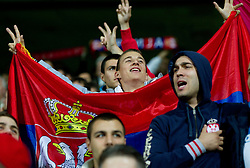 Fans of Serbia during football match between National Teams of Slovenia and Serbia of UEFA Euro 2012 Qualifying Round in Group C on October 11, 2011, in Stadium Ljudski vrt, Maribor, Slovenia.  Slovenia defeated Serbia 1-0. (Photo by Vid Ponikvar / Sportida)