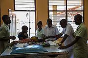 Nurses and attendants caring for a sick child on the children's ward of St Walburg's Hospital, Nyangao. Lindi Region, Tanzania.