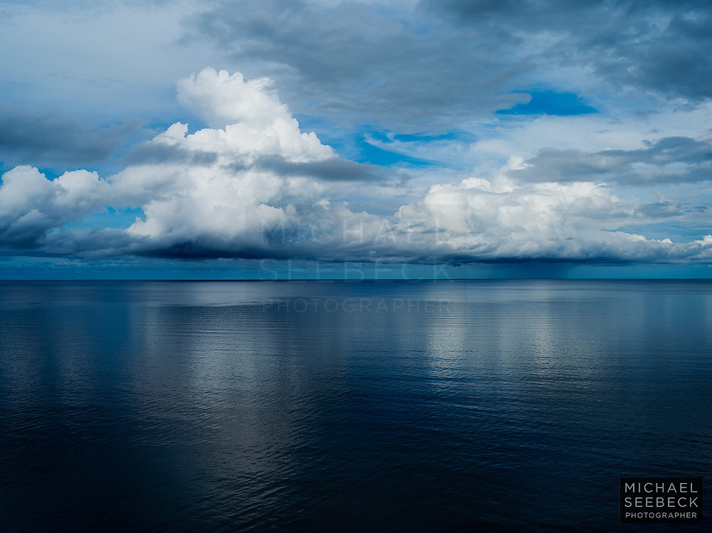 Cumulonimbus clouds developing over the Coral Sea, during a late Summer afternoon, in Great Barrier Reef Waters.<br /> <br /> Code: TAQT0001<br /> <br /> Limited Edition Print