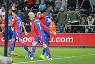 Christian Beneteke of Crystal Palace celebrates his teams fourth goal, 3-4,  during the Premier League match between Swansea City and Crystal Palace at the Liberty Stadium, Swansea, Wales on 26 November 2016. Photo by Andrew Lewis.
