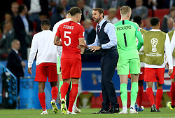 England manager Gareth Southgate (right) talks to John Stones before extra time during the FIFA World Cup 2018, round of 16 match at the Spartak Stadium, Moscow.