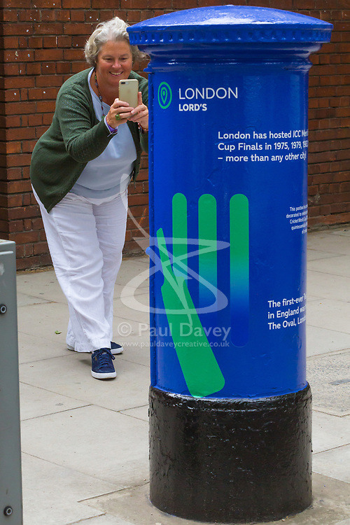 "Claire Harbour snaps one of  Royal Mail's special edition postboxes -<br /> created in collaboration with the International Cricket Council – outside Lord's<br /> Cricket Ground in London. To mark the launch of the ICC Cricket World Cup<br /> this week, the Company has decorated postboxes across the UK in each host<br /> city for the tournament, in honour of the quintessentially British game. The<br /> postboxes are located in London, Manchester, Nottingham, Chester-Le-<br /> Street, Cardiff, Bristol, Southampton, Birmingham, Taunton and Leeds, and<br /> will be transformed for the duration of the tournament."". Lords Cricket Ground, London, May 28 2019."