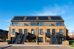Modern new urban housing development by Cala at Ocean Terminal in Leith, Scotland Uk