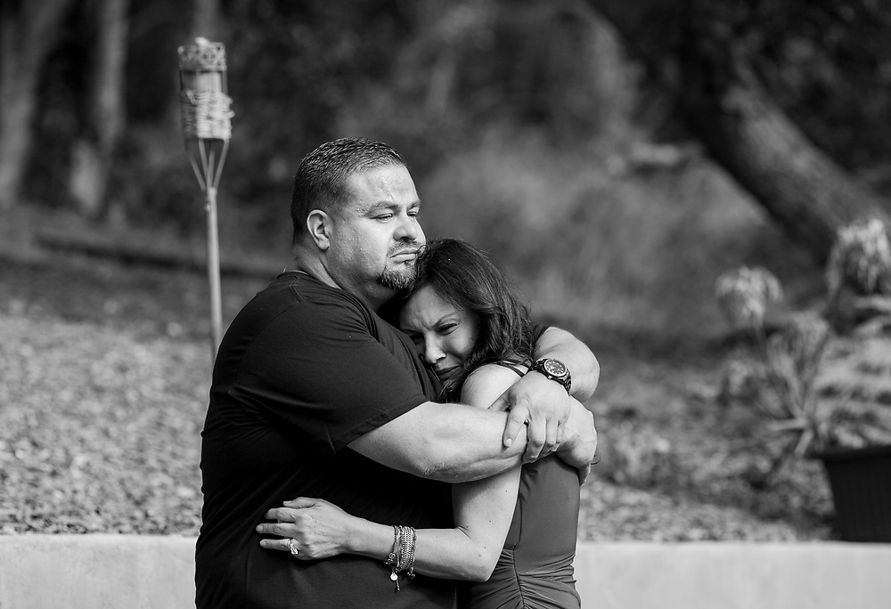 Veronica Ramirez is held by her husband Fernando as she cries at their home in Prunedale, Calif. on July 7, 2016, which would have been her son Nikko Malliarodakis' 25th birthday, Ramirez and family planted a pine and two spruce saplings where they buried his ashes on that day. <br /> <br /> Malliarodakis was killed in a car crash in Moss Landing on March 21, 2016, after 19-year-old Lynnea Hernandez swerved into oncoming traffic and slammed into a car driven by Malliarodakis. He was headed back to work from his Monterey home after having lunch with his fiancee.