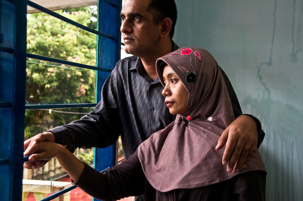 Indonesia, Java. Iraqi refugee and his Indonesian wife await relocation in Australia after seven years as a refugee.