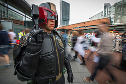 © Licensed to London News Pictures . 26/07/2015 . Manchester , UK . Judge Dread stands guard as people arrive at the venue . Comic Con convention at Manchester Central Convention Centre . Photo credit : Joel Goodman/LNP