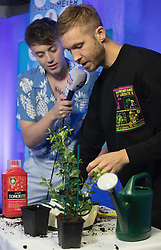 Calvin Harris pots a tomato plant alongside Roman Kemp (left) in the on air studio during Capital's Summertime Ball. The world's biggest stars perform live for 80,000 Capital listeners at Wembley Stadium at the UK's biggest summer party.
