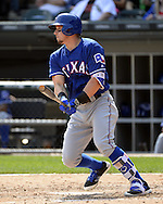 CHICAGO - APRIL 24:  Ryan Rua #16 of the Texas Rangers bats against the Chicago White Sox scores a run on April 24, 2016 at U.S. Cellular Field in Chicago, Illinois.  The White Sox defeated the Rangers 4-1.  (Photo by Ron Vesely)   Subject: Ryan Rua