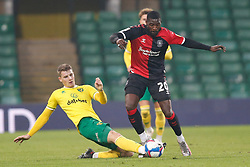 Jacob Lungi Sorensen of Norwich City makes a tackle on Amadou Bakayoko of Coventry City- Mandatory by-line: Phil Chaplin/JMP - 28/11/2020 - FOOTBALL - Carrow Road - Norwich, England - Norwich City v Coventry City - Sky Bet Championship