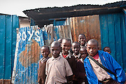 Nairobi, June 2010 - the Jenracy  children's programm and community school  was partially destroyed in a devastating fire. They were able to quickly rebuild  using shipping containers. The rooms were the children sleep were unaffected but the classrooms are now crammed but otherwise functional within the modified steel containers.