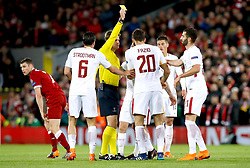 Match Referee Felix Brych gives AS Roma's Federico Fazio a yellow card during the match